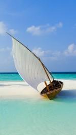 Boat on Maldive beach