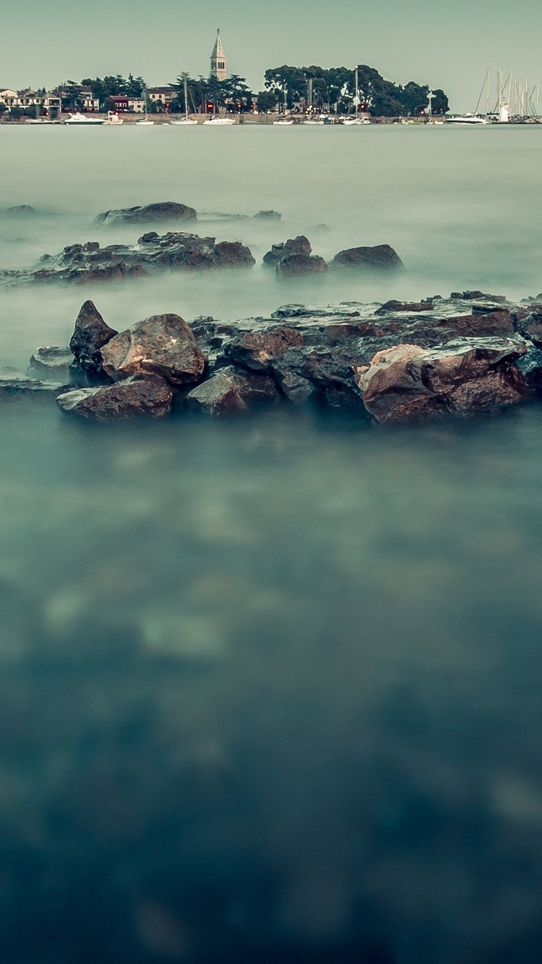 Misty sea and the harbor beach