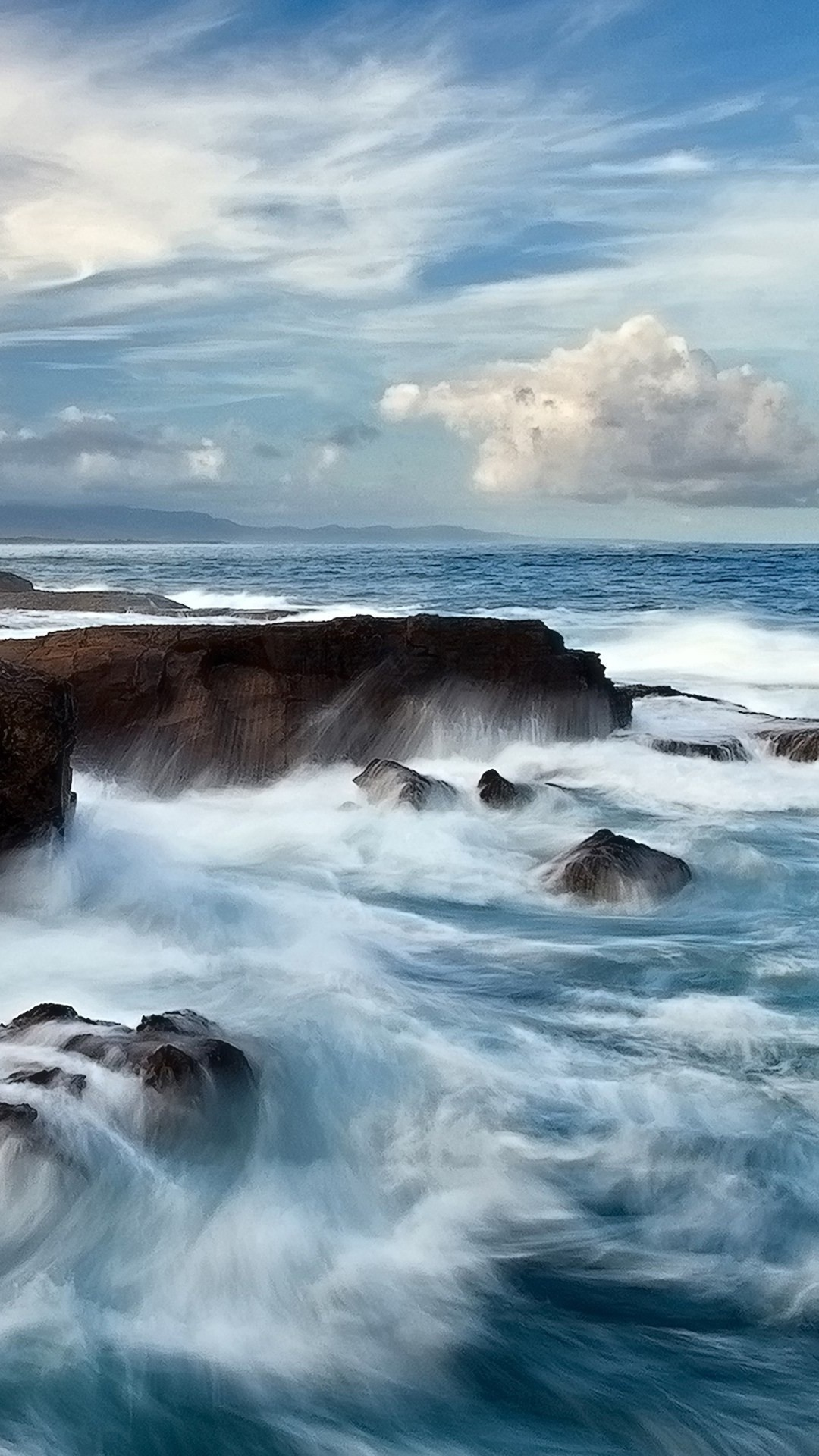 Waves breaking beach