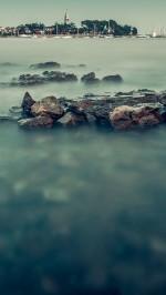 Misty sea and the harbor beach